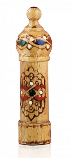 Vial of rose essence in а wooden souvenier Lema